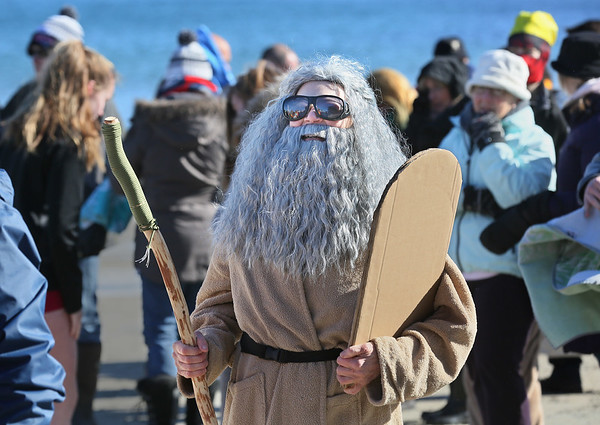 MIKE SPRINGER/Staff photo<br /> Cheryl Keim, a member of the Amesbury Rotary Club, is dressed as Moses before the start of the Gloucester Rotary Club's 8th annual Polar Plunge on Saturday at Long Beach in Gloucester.<br /> 02/03/2018