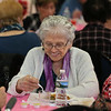 MIKE SPRINGER/Staff photo<br /> Felicia Aiello enjoys her meal during the annual Valentine's Day luncheon Thursday at the Rose Baker Senior Center in Gloucester.<br /> 2/15/2018