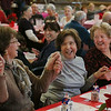 "MIKE SPRINGER/Staff photo<br /> From left, Pauline Pelosi, Vida Lefavour and Maria Millefoglie clasp hands while singing along to the old Dean Martin song  ""That's Amore"" during the annual Valentine's Day luncheon Thursday at the Rose Baker Senior Center. 2/15/2018"