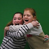 MIKE SPRINGER/Staff photo<br /> Sixth-graders Amelia Costa, left, and Sienna Crocker perform a comic scene in front of a green screen while making a TV commercial spoof about a brand of candy that makes you travel in time when you eat it, at Manchester Essex Regional Middle School in Manchester. The filmmaking equipment was purchased through a grant from the Spaulding Education Fund.<br /> 02/01/2018