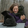 MIKE SPRINGER/Staff photo<br /> Rebecca Baylies, director of development and communications for Cape Ann Animal Aid, plays on Monday with Rubix and Trivia, a pair of labrador-mix puppies, on the agility playground at the Christopher Cutler Rich Animal Shelter in Gloucester. Rubix and Trivia are two of seven puppies that were brought to the shelter recently from Alabama with their mother, Edith. They will be available for adoption in March.<br /> 2/26/2018