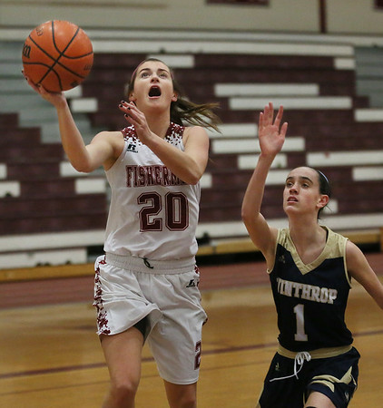 MIKE SPRINGER/Staff photo<br /> Gloucester's Whitney Schrock goes up for a basket as Aliyah Lovell of Winthrop plays defense during varsity basketball play Thursday in Gloucester.<br /> 2/8/2018