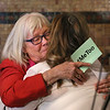 MIKE SPRINGER/Staff photo<br /> Nicole Richon-Schoel, co-chair of the Gloucester Coalition for the Prevention of Domestic Abuse, embraces singer Megan Wolf after her performance Wednesday during the One Billion Rising rally at Gloucester City Hall.<br /> 2/14/2018