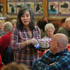 MIKE SPRINGER/Staff photo<br /> Volunteer server Laurie Smith talks with Sam Garrisi during the annual Valentine's Day luncheon Thursday at the Rose Baker Senior Center in Gloucester.<br /> 2/15/2018