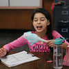 "MIKE SPRINGER/Staff photo<br /> Fifth-grader Belayah Velasquez tastes cotton candy during a ""Chemist's Carnival"" Friday at Beeman Elementary School in Gloucester. Students in all three fifth grade classes took part in the event to celebrate the successful completion of a physical science unit on the structure and properties of matter. The children visited a series of stations to watch the making of a number of carnival treats, including popcorn, snow cones, cotton candy, hot dogs and lemonade. They were then tasked with determining whether the food preparation involved a chemical reaction or a simple non-chemical change in the state of the matter making up the food. They had to justify each opinion with a scientific explanation. Along the way, the children enjoyed a modest portion of each treat.<br /> 2/16/2018"