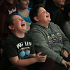 "MIKE SPRINGER/Staff photo<br /> Fourth-graders Logan Gaipo, left, and Sean Frontiero laugh during a ""Slapstick Science"" presentation Tuesday at Veterans Memorial School.<br /> 2/13/2018"
