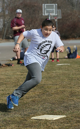 MIKE SPRINGER/Staff photo<br /> Ten-year-old Kiara Olson runs the bases in a timed exercise Wednesday during the Rockport High School Vikings baseball skills clinic. Over 30 children, ages 7-12, are participating in the clinic.<br /> 2/21/2018