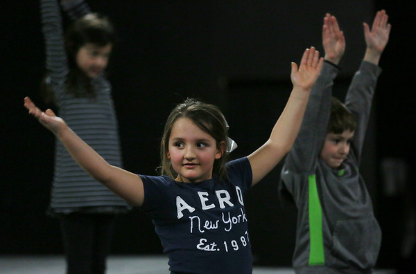 MIKE SPRINGER/Staff photo<br /> Seven-year-old Avery Benjamin of Gloucester takes part in an acting exercise in the Gloucester Stage Company's Youth Acting Workshop at the Gorton Theatre. In the background are 8-year-old Scarlet Lee, left, and 7-year-old Tristan Karvelas, both of Gloucester.<br /> 2/9/2018