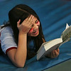 MIKE SPRINGER/Staff photo<br /> Fourth-grader Cassidy Balcome laughs while reading a book during the Cape Ann YMCA's after school program at East Gloucester Elementary School.<br /> 1/19/2018