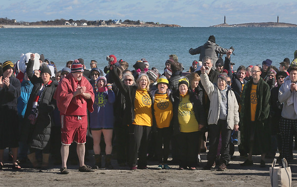 MIKE SPRINGER/Staff photo<br /> A crowd of people gather for the Gloucester Rotary Club's 8th annual Polar Plunge on Saturday at Long Beach in Gloucester. The event raised money to fight polio.<br /> 02/03/2018