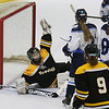 MIKE SPRINGER/Staff photo<br /> Bishop Fenwick goalie Cailyn Wesley holds her glove in the air to indicate that she had caught the puck during varsity hockey action Saturday against Peabody.<br /> 02/03/2018