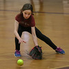 MIKE SPRINGER/Staff photo<br /> Mylee Towne, 9, fields the ball during the varsity softball team's vacation softball clinic Thursday at Gloucester High School.<br /> 2/22/2018