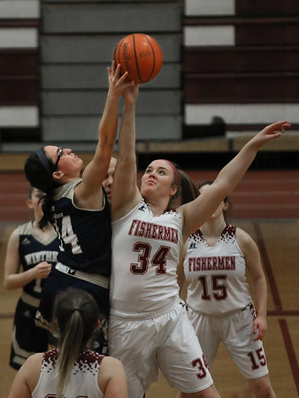 MIKE SPRINGER/Staff photo<br /> Gloucester's Ruby Melvin goes up against Winthrop in the opening tip-off during varsity basketball play Thursday in Gloucester.<br /> 2/8/2018