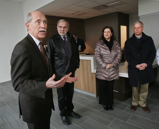 MIKE SPRINGER/Staff photo<br /> Philip Cormier, left, CEO of Beverly and Addison Gilbert hospitals, speaks during a grand opening event Tuesday morning at the new Lahey Health Urgent Care center at Gloucester Crossing. Listening, from left, are Barry Pett, director of community outreach for state Sen. Bruce Tarr; Grace Numerosi, community relations manager for Addison Gilbert Hospital; and Ken Riehl, CEO of the Cape Ann Chamber of Commerce.<br /> 02/06/2018