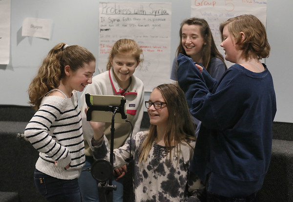 MIKE SPRINGER/Staff photo<br /> A group of sixth graders watch the playback while making a parody TV commercial at Manchester Essex Regional Middle School in Manchester. From left are Amelia Costa, Sienna Crocker, Aidan Nunes, Lilly Brigham and Libby Mulry.<br /> 02/01/2018