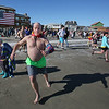 MIKE SPRINGER/Staff photo<br /> Ed Harding of Wakefield makes a dash to the water at the start of the Gloucester Rotary Club's 8th annual Polar Plunge on Saturday at Long Beach in Gloucester. The event raised money to fight polio.<br /> 02/03/2018