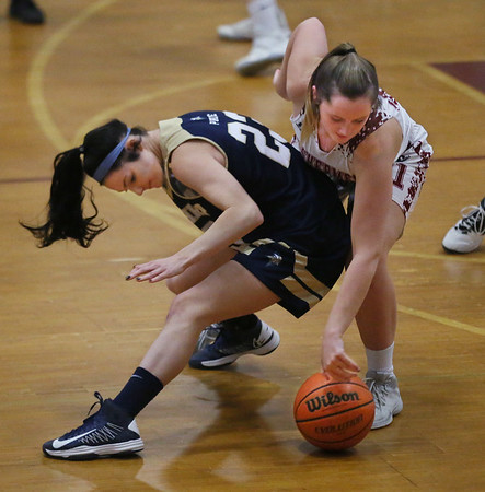 MIKE SPRINGER/Staff photo<br /> Gloucester's Claire Knowlton, right, reaches for the ball after it slipped through the hands of Alana Grillo of Winthrop during varsity basketball play Thursday in Gloucester.<br /> 2/8/2018
