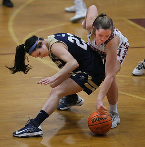 MIKE SPRINGER/Staff photo Gloucester's Claire Knowlton, right, reaches for the ball after it slipped through the hands of Alana Grillo of Winthrop during varsity basketball play Thursday in Gloucester. 2/8/2018