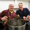 MIKE SPRINGER/Staff photo<br /> Keith Woodman, left, and Scott Weldon hold two of the chief ingredients -- lobsters and clams -- of their new catering business, Essex Clambake, which will open for business soon from a space in the Intershell building on Blackburn Drive.<br /> 2/23/2018