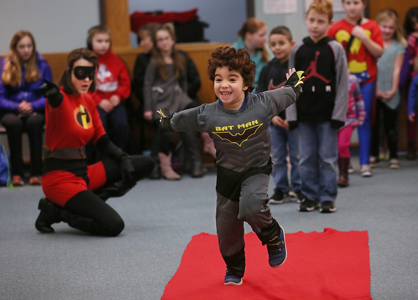 MIKE SPRINGER/Staff photo<br /> Four-year-old Mohamed Beshir practices his superhero sklls dressed as Batman during a superhero-themed storytime Thursday at the Sawyer Free Library in Gloucester. The program was led by actress Carol Finn-Weidman of Beverly, who dressed as a character from the 2004 animated film The Incredibles.<br /> 2/22/2018