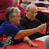 MIKE SPRINGER/Staff photo<br /> Jo Billante, left, and Onofrio Maggiore make a toast during the annual Valentine's Day luncheon Thursday at the Rose Baker Senior Center in Gloucester.<br /> 2/15/2018