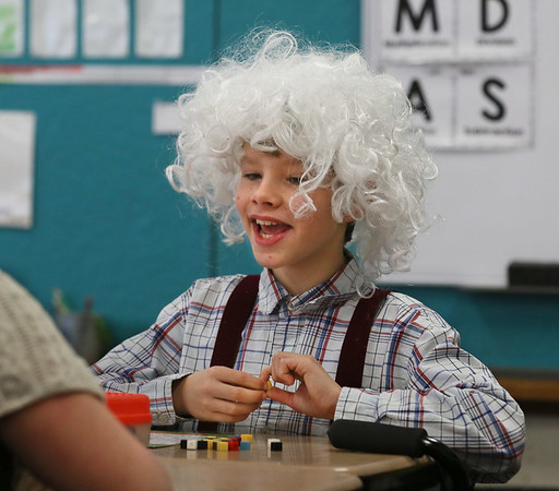 MIKE SPRINGER/Staff photo<br /> Fifth grader Jeremiah Bushfield wears a gray wig and suspenders to portray a 100-year-old man Wednesday as he and other students at East Gloucester Elementary School marked the 100th day of school.