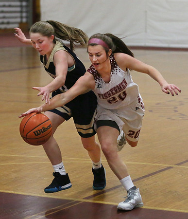 MIKE SPRINGER/Staff photo<br /> Gloucester's Whitney Schrock, right, steals the ball from Sydney Stiglets of Winthrop during varsity basketball play Thursday in Gloucester.<br /> 2/8/2018