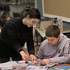 MIKE SPRINGER/Staff photo<br /> Kirsten Vega, education coordinator at the Cape Ann Musseum, teaches 12-year-old Ryan Francis the Japanese art of shibori, an ancient method of dying cloth with indigo, during a workshop Tuesday for members of the Cape Ann YMCA's Teen Leaders club at the museum.<br /> 02/06/2018