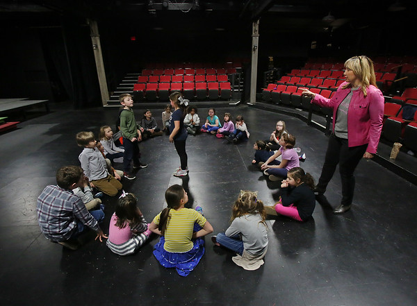 MIKE SPRINGER/Staff photo<br /> Workshop director Heidi Dallin gives instructions to Matthew Conners, 7, and Avery Benjamin, 6, both of Gloucester, during the Gloucester Stage Company's Youth Acting Workshop at the Gorton Theatre.<br /> 2/9/2018