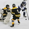 MIKE SPRINGER/Staff photo<br /> Peabody's Sammie Mirasolo, right, tries to move the puck around Bishop Fenwick goalie Abbey Buckley and defender Elise Staunton during varsity hockey action Saturday in Peabody.<br /> 02/03/2018
