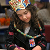 MIKE SPRINGER/Staff photo<br /> Kindergartner Madison Rufful draws a picture of what she imagines she will look like when she is 100 years old while wearing a necklace she made out of 100 pieces of Fruit Loops cereal as she and other students at East Gloucester Elementary School marked the 100th day of school on Wednesday.<br /> 2/7/2018