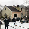 PAUL BILODEAU/Staff photo/Firefighters are on scene at a home fire on Fleetwood Drive in Gloucester.