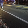 CHRISTA MACDONALD/Staff photo/ Police investigate a rollover on Eastern Avenue, Route 133, in Essex on Saturday night.