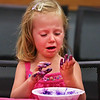 "MIKE SPRINGER/Staff photo<br /> Four-year-old Beatrice Hinderlie reacts to her dirty hands while making ""mermaid slime"" during a children's event Monday at the Sawyer Free Library in Gloucester.<br /> 7/16/2018"