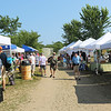 HADLEY GREEN/Staff photo<br /> The Cape Ann Farmers Market sets up behind the visitors center on Thursdays at Stage Fort Park in Gloucester.<br /> <br /> 07/05/2018