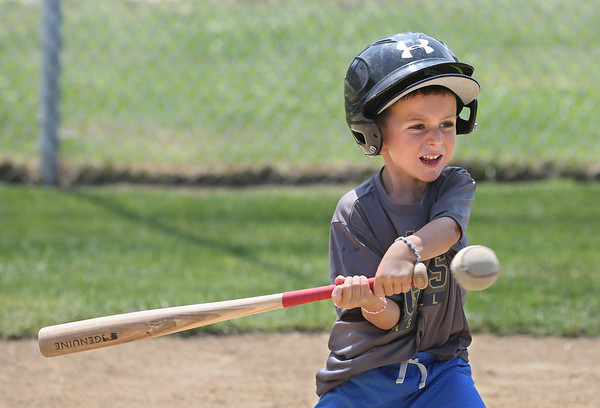 MIKE SPRINGER/Staff photo<br /> Five-year-old Drew Aiello takes a swing at the ball Wednesday during the Legends Baseball Youth Clinic at Wilson Field in Gloucester.<br /> 7/11/2018