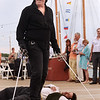 CARL RUSSO/staff photo. GLOUCESTER: Dread Pirate Robert Walsh, right, Artisitc director of the Swashbucklers of the Gloucester Harbour stands over pirate Robert Najarian after winning the sword fight. The Gloucester Stage Co. held their annual  2018 Gala on the Maritime Pier on Saturday (7/28) Dread Pirate (Artistic Director) Robert Walsh, enlisted an outstanding crew of swashbuckling performers to wow and immerse the audience with sword fights, sea songs, and a bit of rum. 7/28/2018