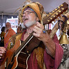 CARL RUSSO/staff photo. GLOUCESTER:  Garold Amadon, aka Gibbon the Troubadour entertains the crowd. The Gloucester Stage Co. held their annual  2018 Gala on the Maritime Pier on Saturday (7/28) Dread Pirate (Artistic Director) Robert Walsh, enlisted an outstanding crew of swashbuckling performers to wow and immerse the audience with sword fights, sea songs, and a bit of rum. 7/28/2018