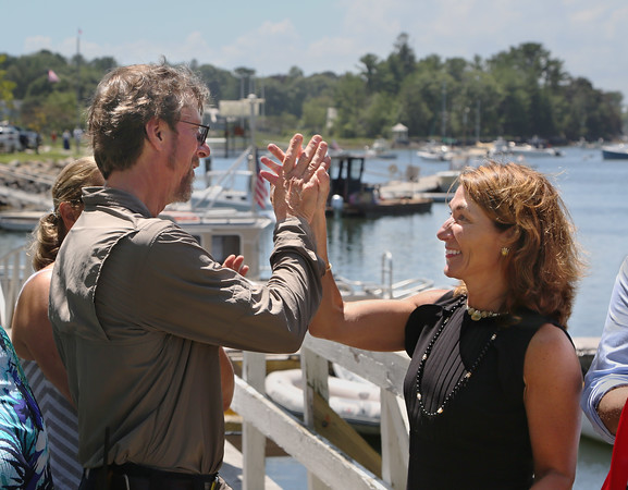 MIKE SPRINGER/Staff photo<br /> Manchester Harbormaster Bion Pike receives a high-five from Massachusetts Lt. Gov. Karyn Polito following a ceremony Tuesday in Manchester announcing a $4 million dredging program to benefit coastal areas including Cape Ann.<br /> 7/24/2018