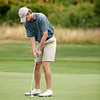Michael Gillis putts during the opening round at Bass Rocks Club Championship, Sunday July 15, 2018. Jared Charney / Photo