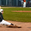 CARL RUSSO/staff photo. Manchester Essex's Michael Deoreo slides hard into third base. He was tagged out. Beverly defeated Manchester Essex in Little League baseball action Thursday night. 7/5/2018