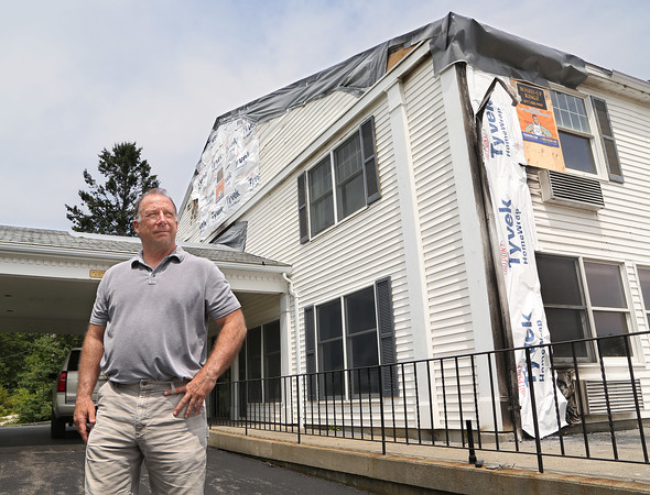 MIKE SPRINGER/Staff photo<br /> Owner Alan Battistelli in front of the Cape Hedge Inn in Rockport on Monday. The inn was badly damaged Sunday in an early morning fire.<br /> 7/30/2018