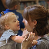 MIKE SPRINGER/Staff photo<br /> Aly Bauer and her daughter Arden, 2, share a moment together in the children's room of the Manchester Public Library.