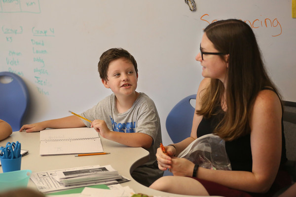 MIKE SPRINGER/Staff photo<br /> Third-grader K.J. Kane talks with teacher Kimberly Demello during a Cape Ann YMCA summer reading class Friday at West Parish Elementary School in Gloucester.<br /> 7/20/2018