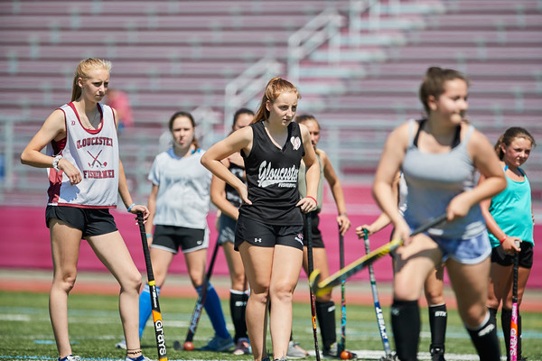Varsity Captains (L) Madison Machado & Jemima Grow help instruct at the Gloucester High School Youth FIeld Hockey Camp, Tuesday, July 10, 2018. Jared Charney / Photo