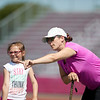 Coach Lauren Riley-Gove gives pointers to Laycee Goodhue at the Gloucester High School Youth FIeld Hockey Camp, Tuesday, July 10, 2018. Jared Charney / Photo