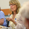 "MIKE SPRINGER/Staff photo<br /> Lynn Murphy of Gloucester tastes a dish Tuesday during a meeting of the ""Cook-a-Book"" Cooking Club at the Sawyer Free Library in Gloucester.<br /> 7/11/2018"