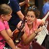 MIKE SPRINGER/Staff photo<br /> Workshop director Alexa Tarantino teaches ten-year-old violinist Sally Elinskas of Rockport during the Rockport Jazz Workshop at Rockport High School. A New York-based saxophonist, composer and educator who summers in Rockport, Tarantino approached Rockport Music with the idea to start the jazz workhop in 2014. Since then, Tarantino and Stephanie Woolf, Director of Education and Outreach at Rockport Music, along with Rockport Public Schools, have grown the program from 7 students to 120 students in 5 years. Students come from 18 towns throughout the state, as well as New Hampshire, Long Island and Brooklyn, New York. The award-winning faculty are performers and educators based in New York City, California and the Midwest. The public will have the opportunity to hear faculty and students when they perform this Wednesday at 7 p.m. at the Shalin Liu Performance Center, and again on Friday at 3:15 pm. at Dock Square.