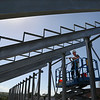 MIKE SPRINGER/Staff photo<br /> A worker with the North Collins, New York-based E&D Specialty Stands Inc. dismantles the bleachers Tuesday at Newell Stadium in Gloucester.<br /> 7/24/2018