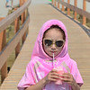 MIKE SPRINGER/Staff photo<br /> Six-year-old Rhian Brigham of Gloucester enjoys an Italian ice on Monday as she walks across the footbridge after a day at Good Harbor Beach in Gloucester.<br /> 7/2/2018